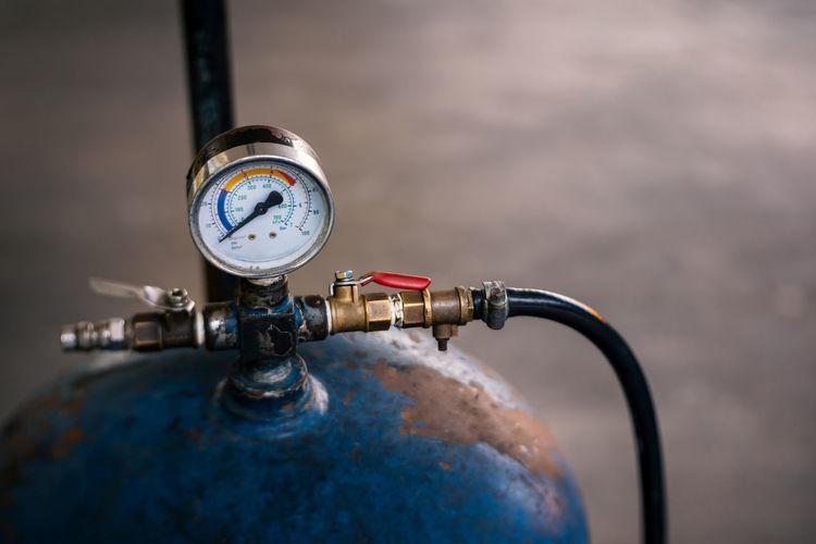 Close-up of gauge on cylinder