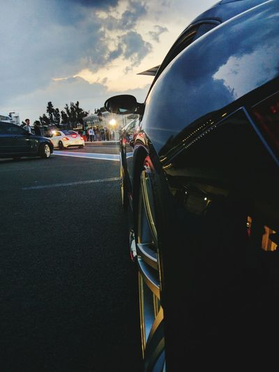 Close-up of cars on road against sky
