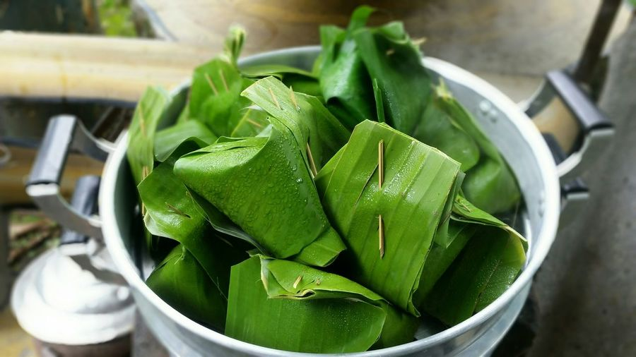 Close-Up Of Banana Leaf Wraps In Steamer