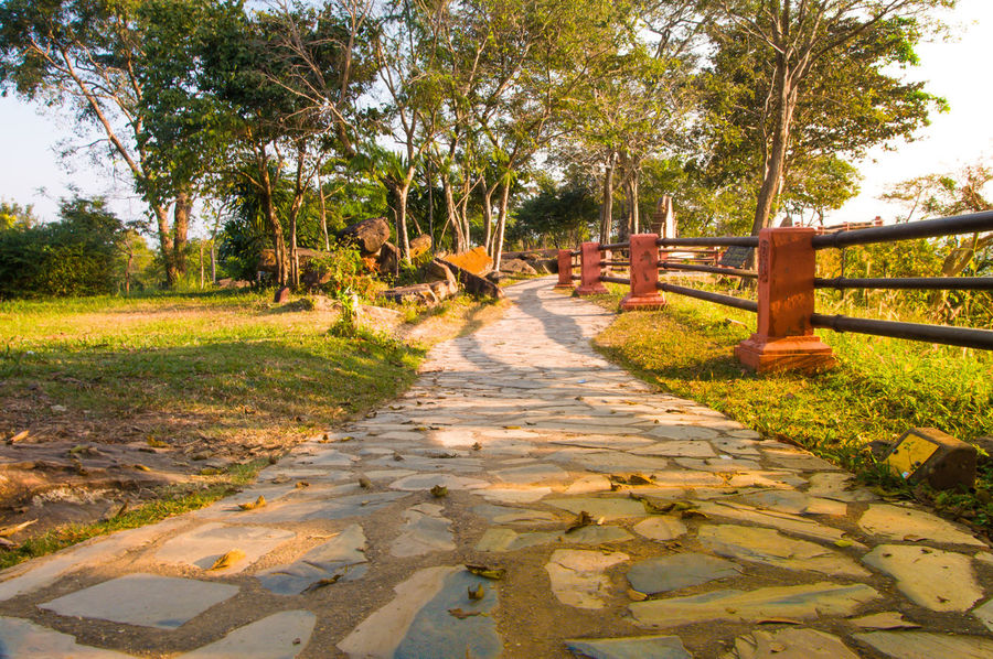 Stone walkway Beauty In Nature Day Grass Growth Nature Nature No People Outdoors Road Scenics Sky Stone Material Stones Tranquil Scene Tree Trees Walkway Walkway To Nature Let's Go. Together.