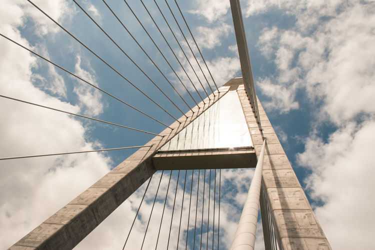 Architecture Bridge Bridge - Man Made Structure Building Story Built Structure Cable Cable-stayed Bridge Cloud Cloud - Sky Cloudy Connection Day Engineering Famous Place Low Angle View Modern No People Outdoors Repetition Sky Steel Cable Suspension Bridge Tall Tall - High Transportation