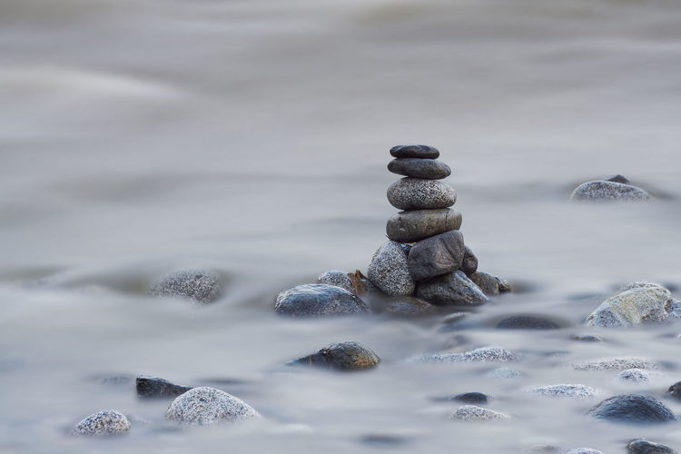 Stack of pebble stones. Concept zen, spa, summer, relax. Beauty In Nature Close-up Cold Temperature Day Nature No People Outdoors Pebble Rock - Object Snow Stack Water Winter