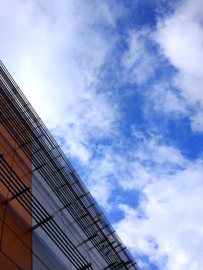 Cloud - Sky Modern Architecture Low Angle View Sky Skyscraper No People Building Exterior Backgrounds Blue City Outdoors Built Structure Day