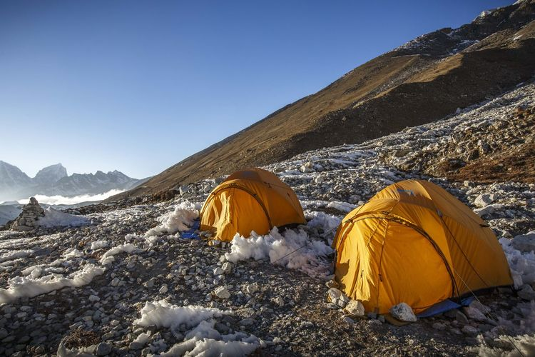 Panoramic view of tent on mountain against sky