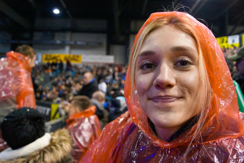 Portrait of female performer with crowd in background in theater