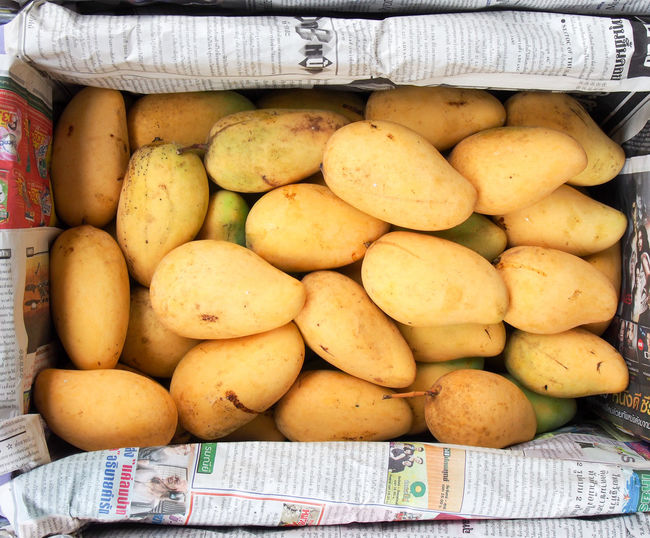 Close-up of mangoes in container