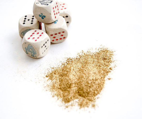 gambling dices and gold powder Business Gambling Gold Golden Las Vegas Luck Lucky Monaco Playing Cards Close-up Dice Entertainment Fortune Gambling Addiction Game Gold Colored Gold Powder Group Of Objects Powder Still Life Studio Shot Wealth White Background