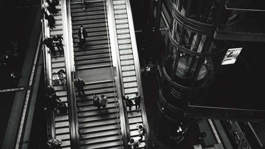 Running to the train Running People Train Travel EyeEm Selects No People Architecture Indoors  High Angle View Built Structure Steps And Staircases Metal Pattern Transportation In A Row City Escalator Day Illuminated The Architect - 2018 EyeEm Awards