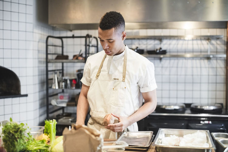 Full length of man standing in kitchen