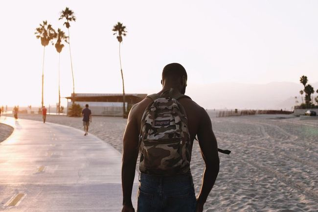 Rear View Leisure Activity Men Togetherness Day Two People Outdoors Real People Clear Sky Young Adult Nature Sky Adult People Adults Only Sunset Santa Monica