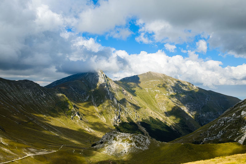 Scenic view of mountains against sky in frontignano, marche italy