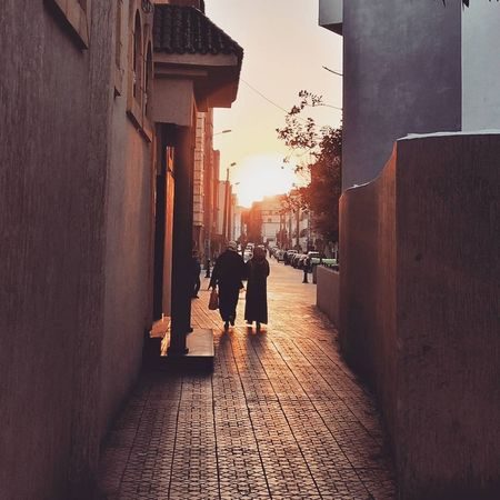City City Life Friends Sunset_collection Walk Walking Around Architecture Building Building Exterior Built Structure Full Length IPhoneography Lifestyles Men Oldfriends Outdoors People Phone PhonePhotography Real People Rear View Sun Sunset The Way Forward Walking