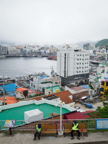 Korea Port City Relaxing Travel Working Hard Building Built Structure Cityscape Crowd Gyeongnam High Angle View People Port Rest Resting Same Pose Scavenger Sleeping Streetsweeper  Sweep Take A Break Tired Tiredness uniqueness Working Life