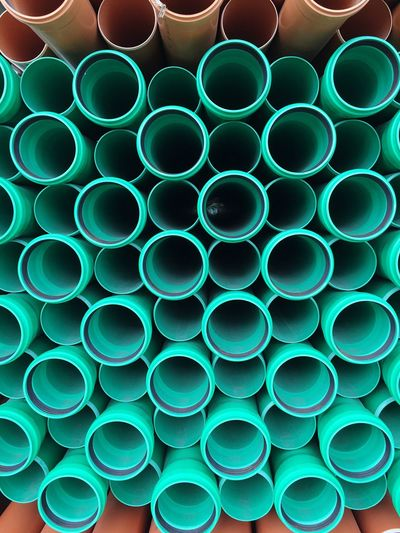 Close-Up Of Stacked Plastic Pipes