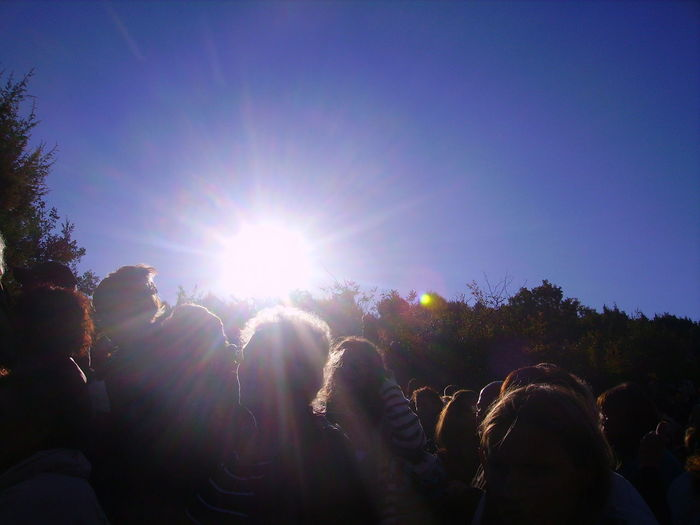 Capture Tomorrow Sky Sunlight Sun Lens Flare Sunbeam Group Of People Real People Nature Crowd Day Plant Clear Sky Sunny Tree Low Angle View Beauty In Nature Lifestyles Leisure Activity Outdoors Large Group Of People Bright Brightly Lit Festival Capture Light