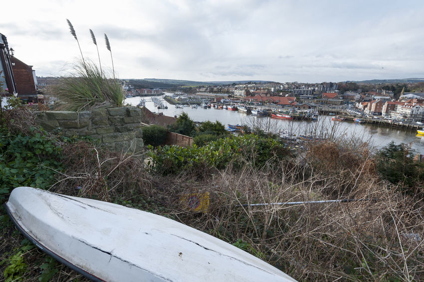 View from close to the Abbey across Whitby, Yorkshire Boat Cloud - Sky Day Elevated View Grass Landscape No People Outdoors River Travel Destinations United Kingdom Water Whitby Whitby Harbour Yorkshire