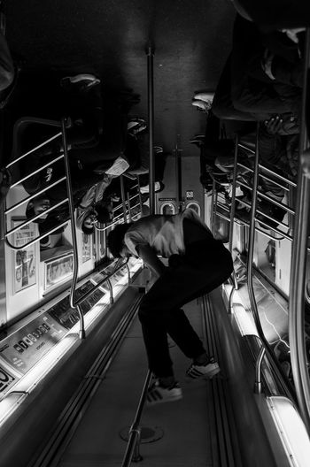 Dancing City Life NYC Streerphotography New York City Blackandwhite Real People Train Interior Commuter Train Men Indoors  Passenger Women Commuter Mode Of Transport Subway Train Transportation Travel Public Transportation Candid Photography Candid Shot Shift Perspective NYC Street Photography