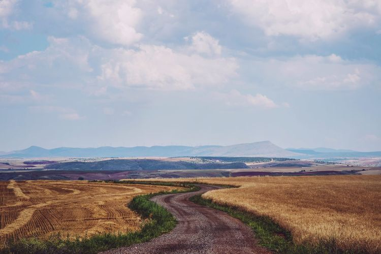 Rural Scene Road Mountain Agriculture Sky Landscape Cloud - Sky Winding Road Empty Road Double Yellow Line Road Marking Country Road Farmland Cultivated Land Dramatic Sky Dividing Line