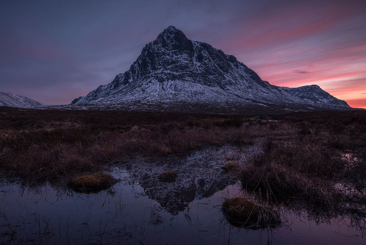 Buachaille etive mor Scotland Mountain Sky Mountain Peak Cloud - Sky Reflection Sunset Snow Dramatic Sky Water Nikonphotography Landscape_photography Sunlight Glencoe
