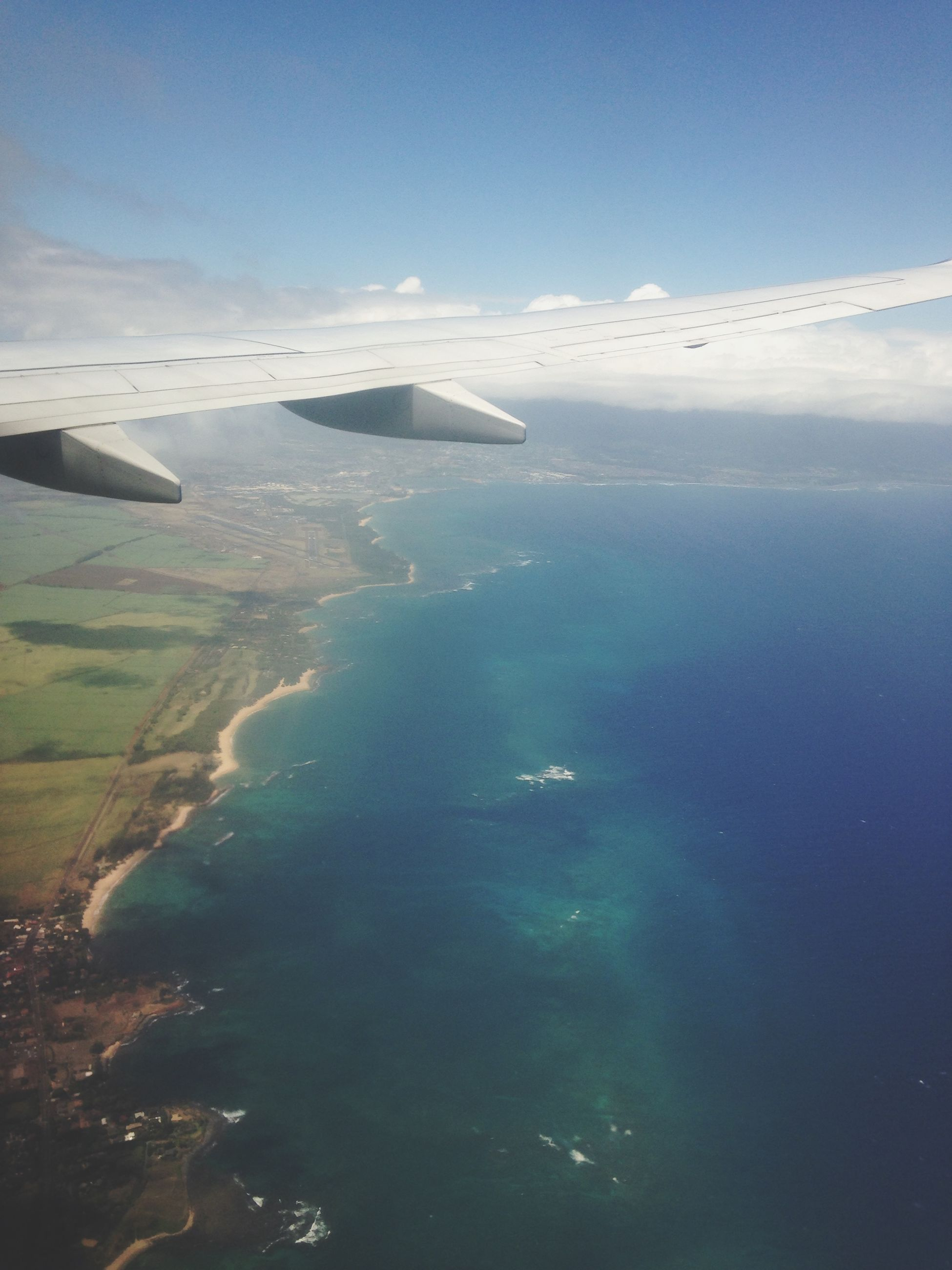 transportation, airplane, aerial view, air vehicle, mode of transport, flying, aircraft wing, sea, scenics, water, part of, mid-air, beauty in nature, travel, cropped, nature, sky, journey, tranquil scene, landscape