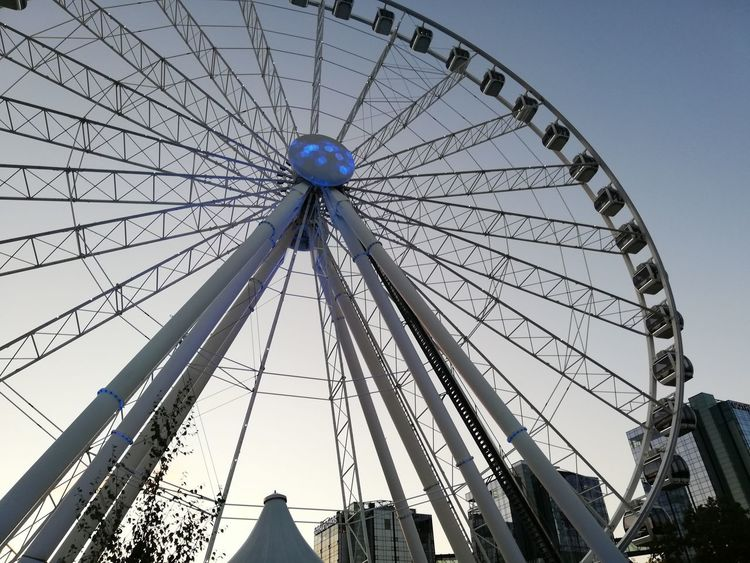 flywheel Amusement Park Amusement Park Ride Architecture Arts Culture And Entertainment Built Structure Circle Clear Sky Day Fairground Ferris Wheel Geometric Shape Large Leisure Activity Low Angle View Nature No People Outdoors Shape Sky Tall - High Wheel
