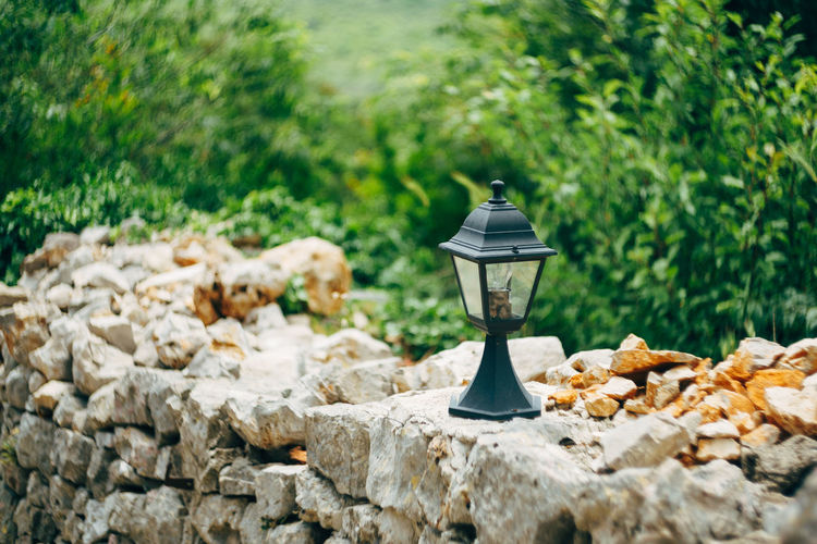 Close-up of electric lamp on rock