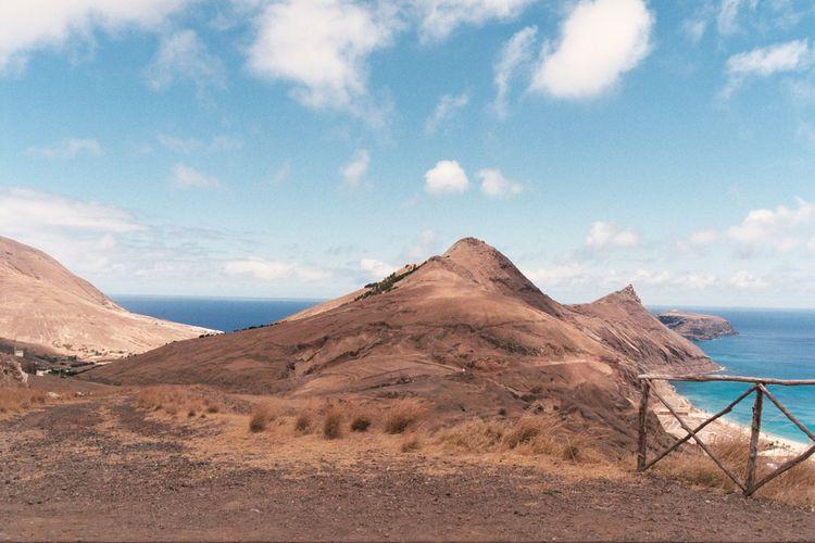 High Angle View Of Coastal Feature Against Calm Sea