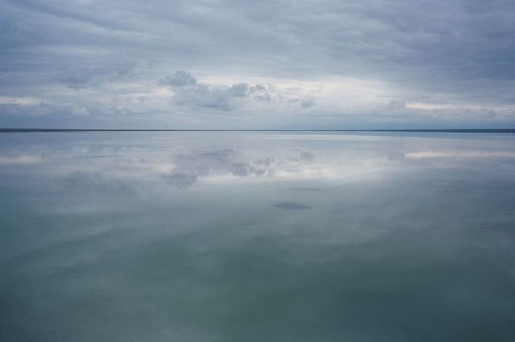Film Photography Reflection Tranquility Cloud - Sky Sky Tranquil Scene Water Nature Beauty In Nature Scenics Day Symmetry No People Outdoors Sea