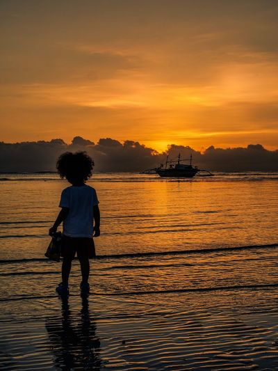 Sunrise baby Travel Silhoutte Photography Silhouette_collection Compositionkillerz Reflection_collection Seascape Sunrise_sunsets_aroundworld Sunrise Water Sunset Sky One Person Real People Scenics - Nature Beauty In Nature Childhood Reflection Rear View Land Silhouette Child Lifestyles Sea Nature Cloud - Sky Outdoors Orange Color Capture Tomorrow Moments Of Happiness EyeEmNewHere