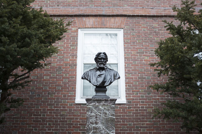 A Bust in Boston: A Day at the Museum Brick Wall Trees Architecture Art And Craft Brick Wall Building Exterior Built Structure Bust  Creativity Day Human Representation Male Likeness Museum No People Outdoors Sculpture Statue Tree