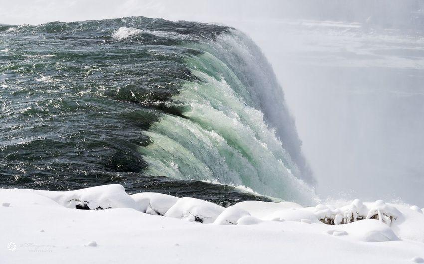 Scenic view of sea waves splashing in winter