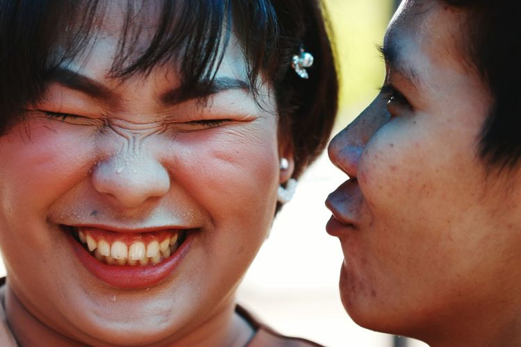 Close-up of woman kissing friend