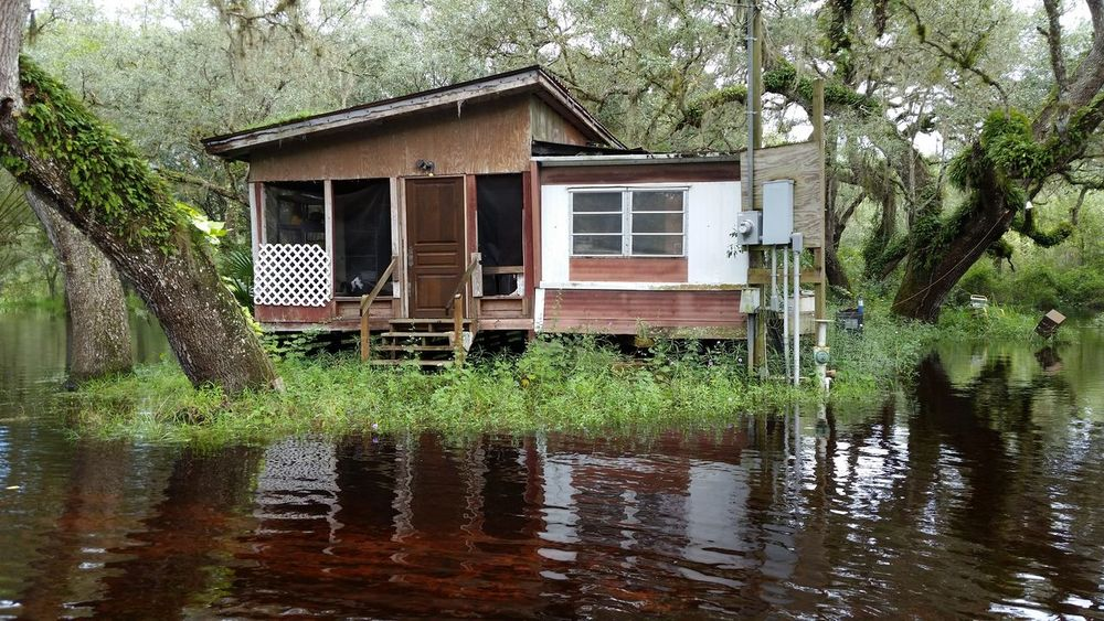 old trailer with house add-on along the river Day Flooding House Myakka River Florida No People Oak Hammock Outdoors Reflection River House Trailer Tree Water Waterfront
