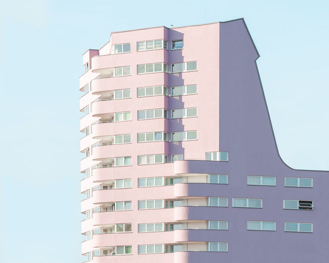 Pastel Power Afternoon Sun Apartment Architecture Building Building Exterior Built Structure City Clear Sky Day Golden Hour Low Angle View Modern Nature No People Office Building Exterior Outdoors Pastel Residential District Sky Skyscraper Tall - High Tower Window