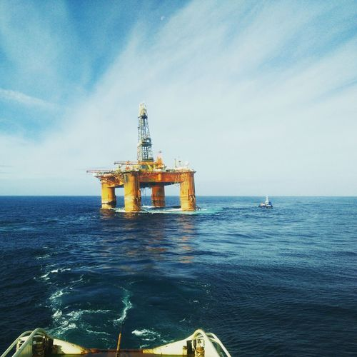 Oil Platform At Sea Against Sky