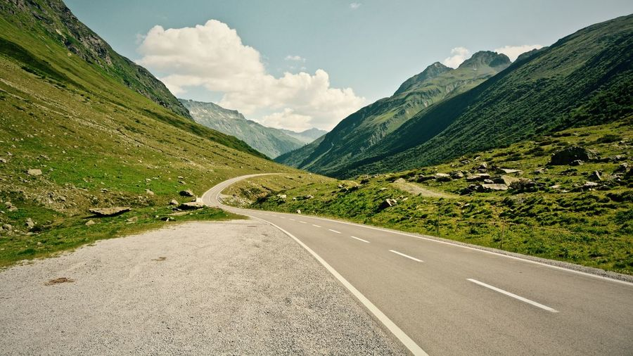 Country road leading towards mountains
