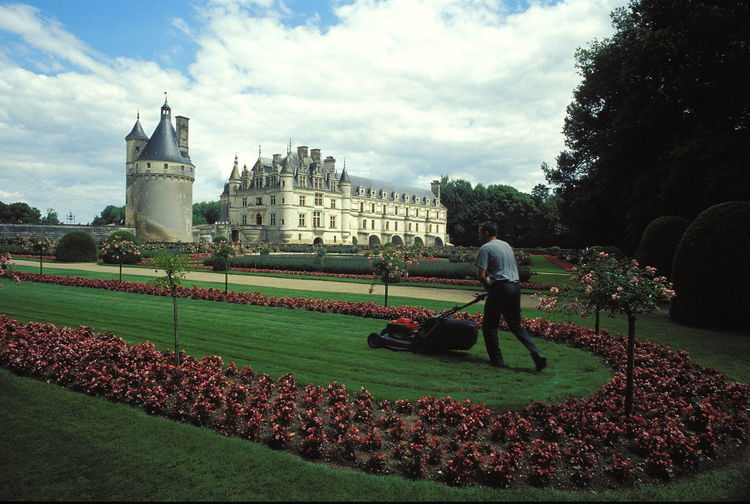 Adult Architecture Building Exterior Built Structure Castle Chenonceau Cloud - Sky Day French Renaissance Gardener Grass Lawn Man Mowing Mowing The Grass Mowing The Lawn Outdoors People Real People Renaissance Renaissance Castle Sky Tower Travel Destinations