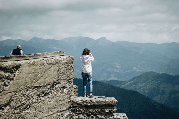View on Mitarbi One Person Standing Leisure Activity Real People Mountain Scenics - Nature Full Length Lifestyles Mountain Range Day Beauty In Nature Nature Tranquility Sky Rear View Non-urban Scene Casual Clothing Tranquil Scene Women Outdoors The Photojournalist - 2018 EyeEm Awards The Great Outdoors - 2018 EyeEm Awards Summer Road Tripping