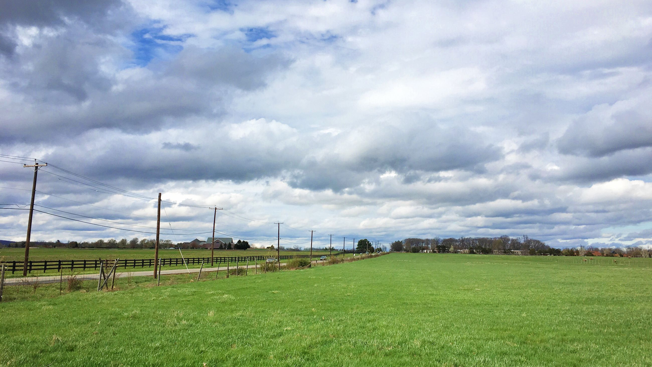 field, grass, sky, landscape, cloud - sky, cloudy, grassy, rural scene, green color, agriculture, tranquil scene, tranquility, nature, farm, scenics, beauty in nature, cloud, growth, overcast, fence