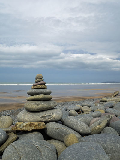Holistic stones on the pebble ridge at Westward Ho! in beautiful Devon Solid Stone - Object Rock Stack Rock - Object Cloud - Sky Sky Zen-like Tranquility Stone Beauty In Nature Pebble Balance Water Nature Tranquil Scene Scenics - Nature Sea No People Horizon Over Water Outdoors Holistic Zen Holistic Stone Stack Westward Ho! Mindfulness Wellbeing Devon England Coastal Feature Dramatic Sky