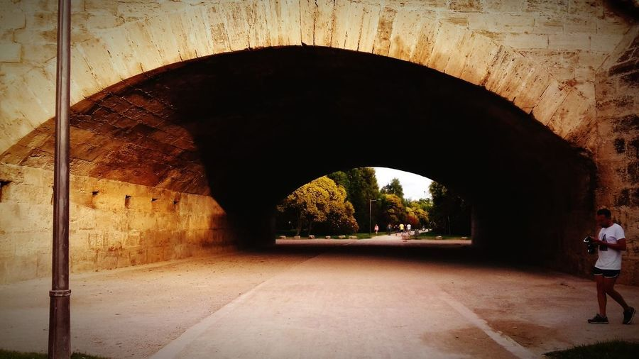 There is always a path at the end of the tunnel Look At The End Old Bridge Valencia, Spain Sparetime Paths Tunnel Peaceful Keepgoing EyeEm Nature Lover Eye Em Best Shots -Landscapes Parks Sports And Nature City Moments Turia City Arch Tunnel Architecture Built Structure Bridge - Man Made Structure Focus On Shadow The Architect - 2018 EyeEm Awards
