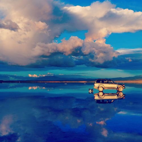Cloud - Sky Sky Tranquility Reflection Scenics Sea Nature Water Outdoors Beauty In Nature Tranquil Scene No People Day Horizon Over Water Drone  Uyuni Salt Flat Uyuni Uyuni, Bolivia