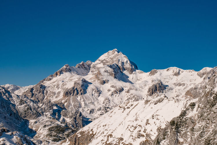 Slovenia Triglav National Park Alps Beauty In Nature Blue Clear Sky Cold Temperature Day Landscape Low Angle View Mountain Mountain Range Nature No People Outdoors Scenics Sky Snow Tranquil Scene Tranquility Triglav