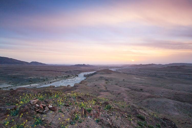 Sunset over Feynan desert ASIA Desert Feynan Jordan Landmark Middle East Safety Sky Sunset Touristis