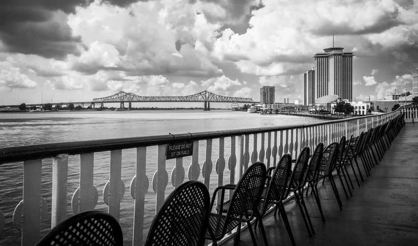 Chair Natchez New Orleans Architecture Bridge Bridge - Man Made Structure Building Exterior Built Structure City Cloud - Sky Mississipi No People Outdoors River Ship Sky Skyscraper Suspension Bridge Travel Destinations Water Waterfront