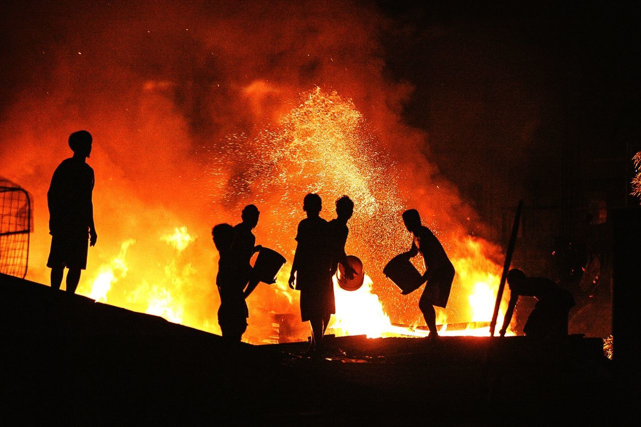 fire - natural phenomenon, flame, heat - temperature, burning, real people, orange color, firefighter, silhouette, glowing, men, night, fire hose, standing, outdoors, togetherness, spraying, bonfire, occupation, water, people, adult