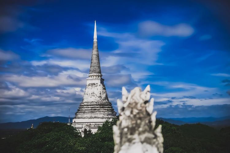 Low angle view of temple building against cloudy sky