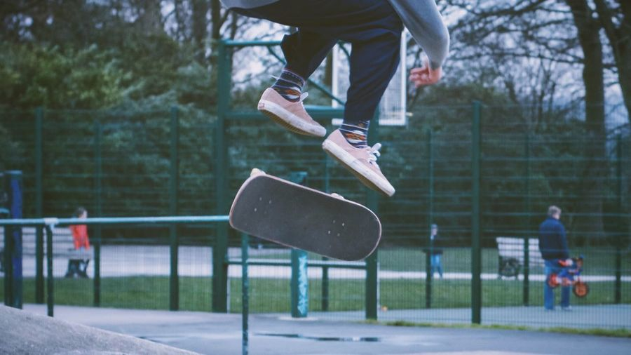 EyeEm Selects EyeEm Gallery Focus On Foreground Mid-air Sport Real People Leisure Activity One Person Motion Outdoors Skateboard Lifestyles Fun Park - Man Made Space Low Section Skill  Tree Jumping Playing Day