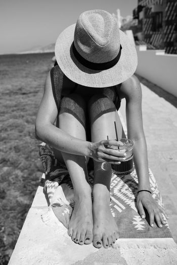 Person with a hat and cold coffee - Aegean, Greece 2018 Aegean Coffee Halki Hat Portrait Of A Woman Beach Clothing Day Greece Hat Ice Coffee Leisure Activity Lifestyles One Person Portrait Real People Shadows Summer Sunbathing Swimwear Water Women My Best Photo