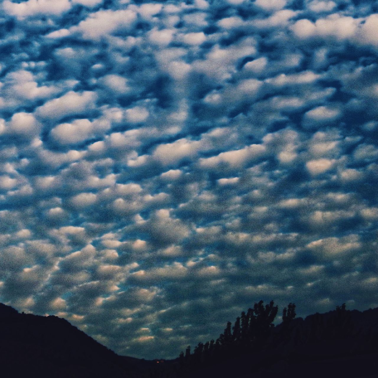 cloud - sky, sky, beauty in nature, scenics - nature, no people, tranquility, tranquil scene, nature, low angle view, mountain, silhouette, outdoors, dusk, day, architecture, sunset, cloudscape, idyllic, dramatic sky, mountain peak, ominous